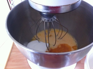 Whisking the eggs with sugar and vanilla extract together.