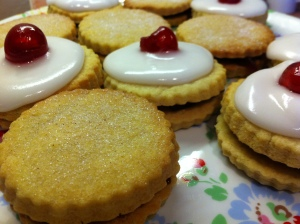 Cherry Bakewell Jam Sandwich cookies and plain jam sandwich cookies dusted with caster sugar.