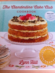 The pretty pastel retro feel front cover of The Clandestine Cake Club Cookbook