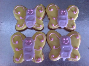 Pastel yellow and lilac butterfly vanilla shortbread cookies.