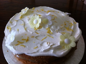 The Lemon Layer cake has Dr Oetker edible wafer daisies on top of it, alongside some shaved lemon zest.