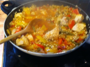 The paella begins to thicken up as the rice grains swell. Every now and again I ladelled in some more chicken stock.