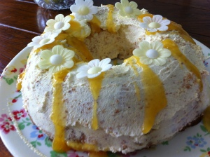 The cake was decorated with the whipped cream  and drizzled lemon curd. The GBBO version had passionfruit on it. I couldn't find any passionfruit in the shops so I used some yellow and white Dr Oetker wafer daisies to complement the colours of the cake.