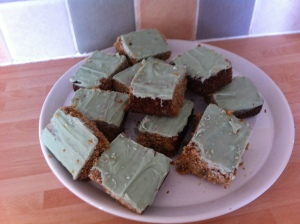 Lemon, Ginger and Coconut Flapjacks using melted lemon chocolate buttons from The York Cocoa House on top.
