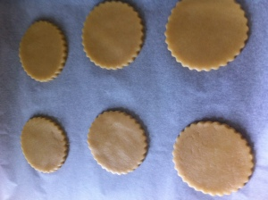 The biscuits are cut out into fluted rounds and placed on baking trays.