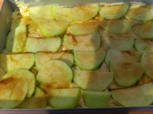 A layer of sliced apples dusted with cinnamon was added to the traybake.