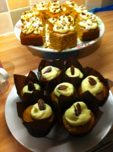 Thanksgiving Pumpkin Cake (back) and Pumpkin Spice Cupcakes with Cream Cheese Frosting.