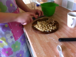 My daughter's friend set to chopping up some walnuts to go in the filling of the cake.