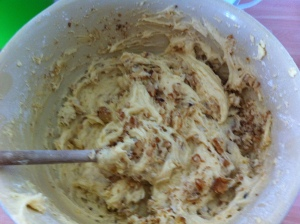 All the ingredients (butter, sugar, eggs, self raising flour, baking powder and the chopped walnuts) were all added to the mixing bowl and beaten until thoroughly blended.
