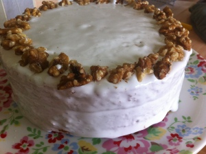 The finished cake, filled sandwiched and topped with more walnut frosting.  The cake was finished with walnut halves.